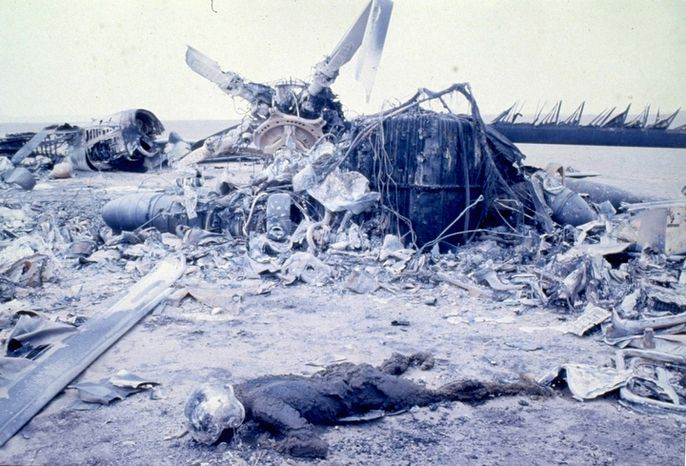 The remains of severely burned bodies of U.S. Marines are pictured amidst the wreckage of U.S. aircraft, including helicopters and giant transporters, after an abortive Commando-style raid into Iran aimed at freeing hostages being held at the U.S. Embassy.  The desert site is in Eastern Iran at Desht-E-Kavir, some 500 kilometers from Tehran.  At least eight U.S. servicemen died in the mission on April 24, 1980.  (AP Photo)