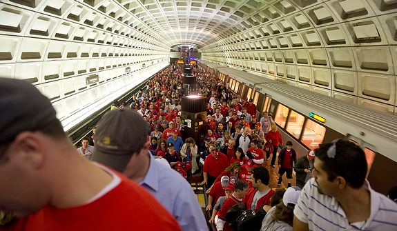Washington Nationals fans crowd the platform at the Navy Yard station on their way to the ballpark for the first home game in the National League Division Series on Wednesday, Oct. 10, 2012. (Barbara L. Salisbury/The Washington Times)