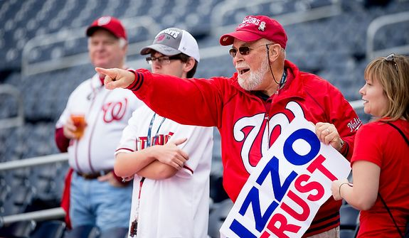 Fans watch warm ups before the Washington Nationals play the St. Louis Cardinals in game three of Major League Baseball playoffs at Nationals Park, Washington, D.C., Wednesday, October 10, 2012. (Andrew Harnik/The Washington Times)