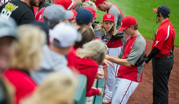 Washington Nationals pitcher Tyler Clippard signs autographs Oct. 10, 2012, prior to Game 3 of the National League Division Series between the Nationals and St. Louis Cardinals at Nationals Park in Washington, D.C. (Rod Lamkey Jr./The Washington Times)