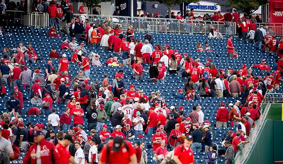 Fans leave the stadium after the Washington Nationals lose to the St. Louis Cardinals 8-0 in game three of the National League Division Series at Nationals Park, Washington, D.C., Wednesday, October 10, 2012. (Andrew Harnik/The Washington Times)