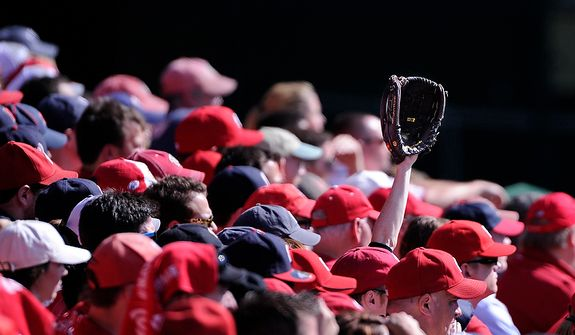 A lone glove rises out of the right field stands during Game 3 of the National League Division Series at Nationals Park, Washington, D.C.., Oct. 10, 2012. (Preston Keres/Special to The Washington Times)