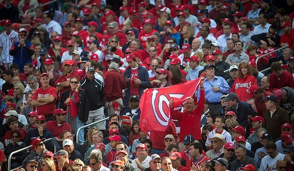 Fans wave their flag in the stands as the Washington Nationals host the St. Louis Cardinals for Game 3 of the National League Division Series at Nationals Park in Washington, D.C., Wednesday, Oct. 10, 2012. (Rod Lamkey Jr./The Washington Times)