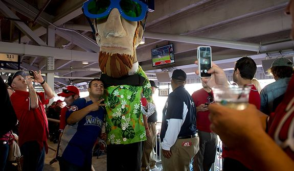 """Jose Salmeron of Arlington, Va. has his picture taken with Abe Lincoln, one of the """"Four Presidents,"""" at Nationals Park in Washington, D.C. on Wednesday, Oct. 10, 2012. (Barbara L. Salisbury/The Washington Times)"""