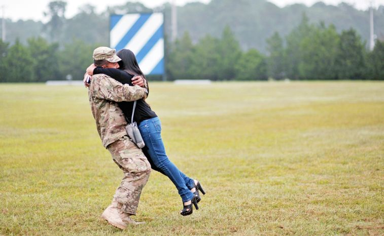 Army PFC Fabian Castrillon hugs his fiancee Marivel Penalea, right, during a welcome home ceremony for 100 soldiers from the Army's 1st Battalion, 30th Infantry Regiment, Wednesday, Oct. 10, 2012 at Fort Stewart, Ga. Overall about 2,200 soldiers from Fort Stewartís 3rd Infantry Division have deployed to Afghanistan this year. (AP Photo/Stephen Morton)