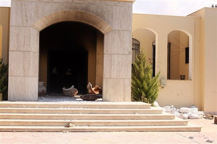 The U.S. Consulate in Benghazi, Libya, damaged a day earlier by protesters angry over a film that ridicules Islam's Prophet Muhammad, is pictured on Wednesday, Sept. 12, 2012. The U.S. ambassador to Libya and three other Americans were killed. (AP Photo/Ibrahim Alaguri)