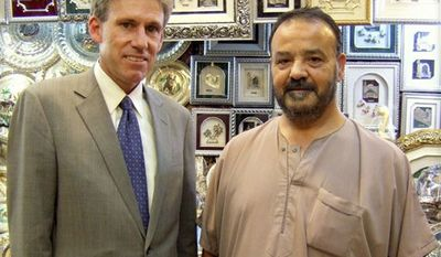 In this photo posted on the U.S. Embassy in Tripoli's Facebook page on Wednesday, Aug. 12, 2012, U.S. Ambassador to Libya J. Christopher Stevens (left) poses with a shop owner in Tripoli, Libya. Libyan officials say Mr. Stevens and three other Americans were killed in an attack on the U.S. Consulate in the eastern city of Benghazi by protesters angry over a film that ridicules Islam's Prophet Muhammad. (AP Photo/U.S. Embassy in Tripoli)