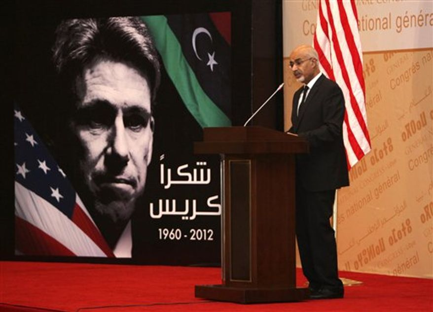 Libyan President Mohammed el-Megarif speaks during a memorial service in Tripoli, Libya, on Thursday, Sept. 20, 2012, for J. Christopher Stevens, the U.S. ambassador to Libya, and three consulate staff members killed in Benghazi on Sept. 11. (AP Photo/Abdel Magid al-Fergany)