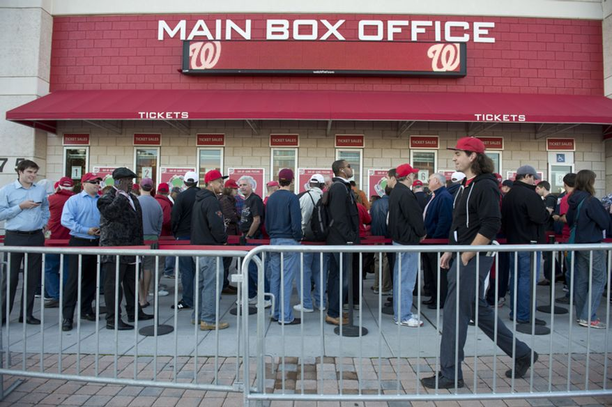 Washington Nationals fans wait in line to buy tickets to the Nats' first home playoff game on Wednesday, Oct. 10, 2012. Standing-room-only seats were being sold for $30 each, and 829 tickets were available for purchase. (Barbara L. Salisbury/The Washington Times)