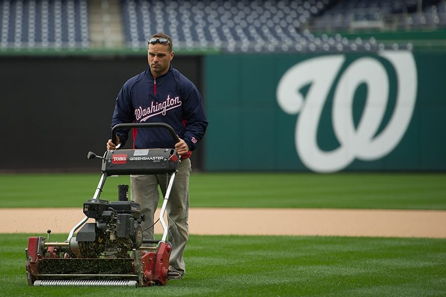 Head groundskeeper John Turnour gets ready for game three at Nationals Park, where the Washington Nationals will take on the St. Louis Cardinals in the first round of the Major League Baseball playoffs in Washington on Monday, Oct. 8, 2012. (Andrew Harnik/The Washington Times)