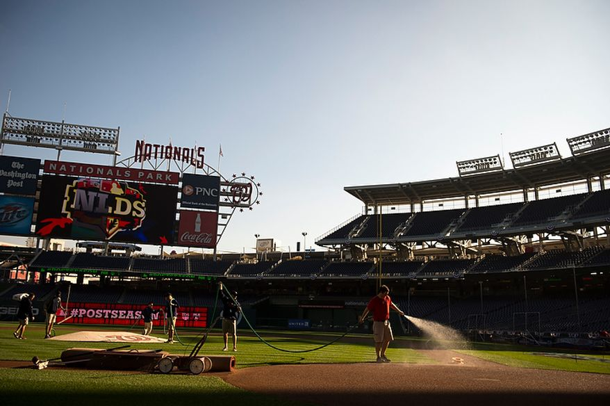 The grounds crew prepares the infield before the Washington Nationals host the St. Louis Cardinals for game three of the National League Division Series at Nationals Park in Washington on Wednesday, Oct. 10, 2012. (Rod Lamkey Jr./The Washington Times)