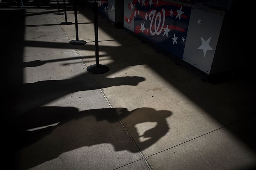 The shadows of fans are seen on the concourse before the Washington Nationals host the St. Louis Cardinals for game three of the National League Division Series at Nationals Park in Washington on Wednesday, Oct. 10, 2012. (Rod Lamkey Jr./The Washington Times)