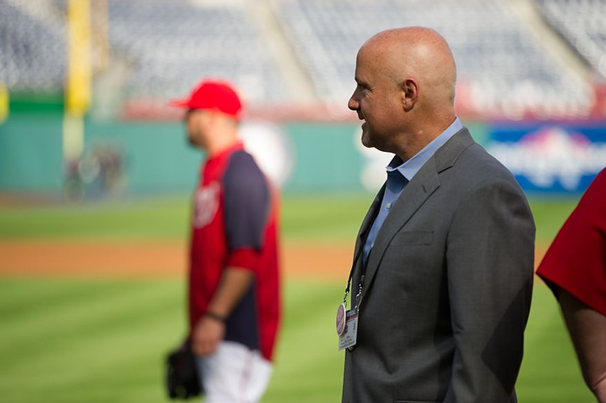 Washington Nationals general manager Mike Rizzo watches warm-ups before the Nats play the St. Louis Cardinals in game three of the National League Division Series at Nationals Park in Washington on Wednesday, Oct. 10, 2012. (Andrew Harnik/The Washington Times)
