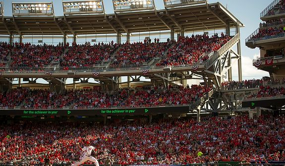 Nationals' Edwin Jackson delivers the first pitch in the top of the first inning as the Washington Nationals host the St. Louis Cardinals for Game 3 of the National League Division Series at Nationals Park in Washington, D.C., Wednesday, Oct. 10, 2012. (Rod Lamkey Jr./The Washington Times)