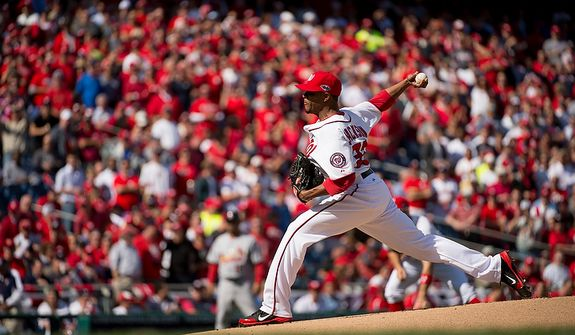 Washington Nationals starting pitcher Edwin Jackson (33) pitches in the first inning as the Washington Nationals play the St. Louis Cardinals in game three of Major League Baseball playoffs at Nationals Park, Washington, D.C., Wednesday, October 10, 2012. (Andrew Harnik/The Washington Times)