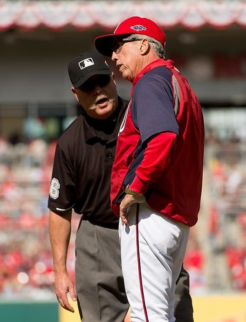 Washington Nationals manager Davey Johnson (5) argues a call with the first base umpire in the second inning as the Washington Nationals play the St. Louis Cardinals in game three of Major League Baseball playoffs at Nationals Park, Washington, D.C., Wednesday, October 10, 2012. (Andrew Harnik/The Washington Times)