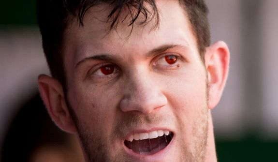 Washington Nationals center fielder Bryce Harper (34) wears red contacts as the Washington Nationals play the St. Louis Cardinals in game three of Major League Baseball playoffs at Nationals Park, Washington, D.C., Wednesday, October 10, 2012. (Andrew Harnik/The Washington Times)