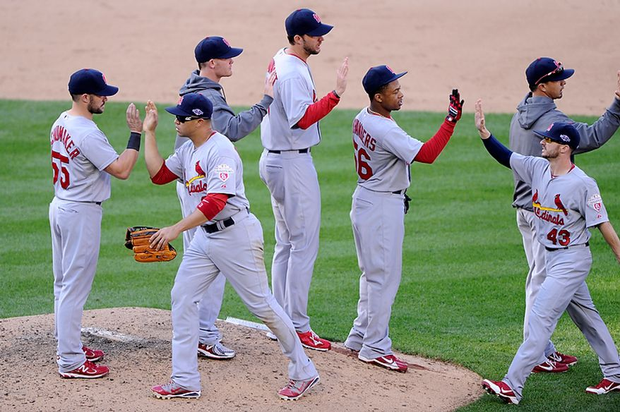 The St. Louis Cardinals congratulate each other after a 8-0 win over the Nationals in Game 3 of the National League Division Series at Nationals Park, Washington, D.C.., Oct. 10, 2012. (Preston Keres/Special to The Washington Times)