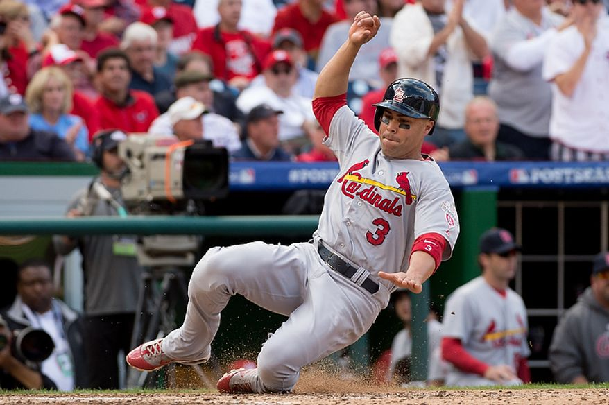St. Louis Cardinals right fielder Carlos Beltran (3) slides across home plate as he and St. Louis Cardinals center fielder Jon Jay (19) score in the eighth inning to put the St. Louis Cardinals up 8-0 against the Washington Nationals in game three of the National League Division Series at Nationals Park, Washington, D.C., Wednesday, October 10, 2012. (Andrew Harnik/The Washington Times)