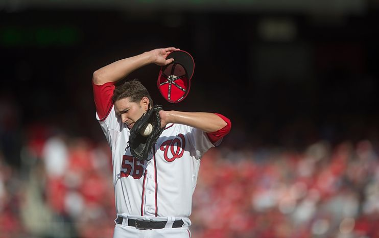 Nationals' relief pitcher Christian Garcia wipes his brow following a conference on the mound in the top of the seventh inning as the Washington Nationals host the St. Louis Cardinals for Game 3 of the National League Division Series at Nationals Park in Washington, D.C., Wednesday, Oct. 10, 2012. (Rod Lamkey Jr./The Washington Times)