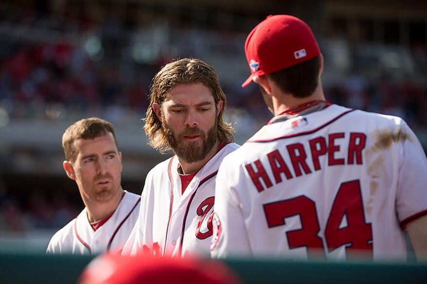 Left to right: Washington Nationals first baseman Adam LaRoche (25), right fielder Jayson Werth (28), and center fielder Bryce Harper (34), get ready to take the field for the top of the sixth inning as the Washington Nationals play the St. Louis Cardinals in game three of the National League Division Series at Nationals Park, Washington, D.C., Wednesday, October 10, 2012. (Andrew Harnik/The Washington Times)