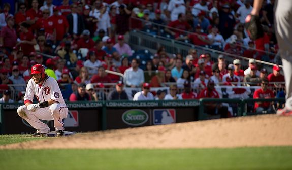 Washington Nationals right fielder Jayson Werth (28) squats on third base between plays in the fifth inning as the Washington Nationals play the St. Louis Cardinals in game three of the National League Division Series at Nationals Park, Washington, D.C., Wednesday, October 10, 2012. (Andrew Harnik/The Washington Times)