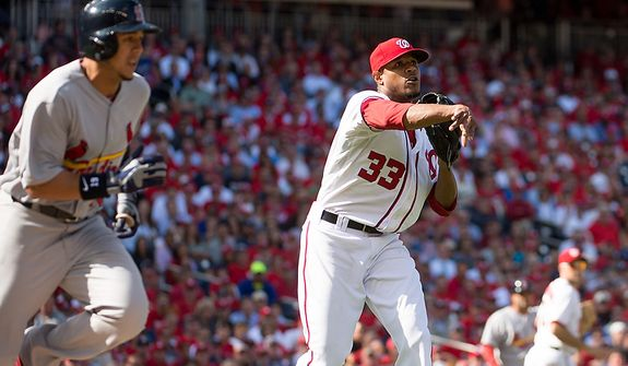 Washington Nationals starting pitcher Edwin Jackson (33) throws out St. Louis Cardinals center fielder Jon Jay (19) on a bunt in the fifth inning as the Washington Nationals play the St. Louis Cardinals in game three of Major League Baseball playoffs at Nationals Park, Washington, D.C., Wednesday, October 10, 2012. (Andrew Harnik/The Washington Times)