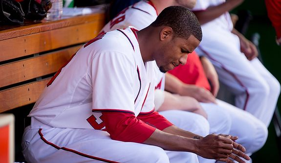 Washington Nationals starting pitcher Edwin Jackson (33) sits in the dugout after giving up 3 runs in the second inning as the Washington Nationals play the St. Louis Cardinals in game three of Major League Baseball playoffs at Nationals Park, Washington, D.C., Wednesday, October 10, 2012. (Andrew Harnik/The Washington Times)
