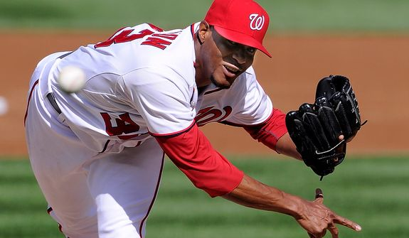 Washington Nationals starting pitcher Edwin Jackson (33) gave up four earned runs in five innings pitches to lose Game 3 of the National League Division Series at Nationals Park, Washington, D.C., Oct. 10, 2012. (Preston Keres/Special to The Washington Times)
