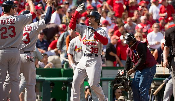 St. Louis Cardinals shortstop Pete Kozma (38) hits a three run homer in the second inning to put the St. Louis Cardinals up 4-0 as the Washington Nationals play the St. Louis Cardinals in game three of Major League Baseball playoffs at Nationals Park, Washington, D.C., Wednesday, October 10, 2012. (Andrew Harnik/The Washington Times)