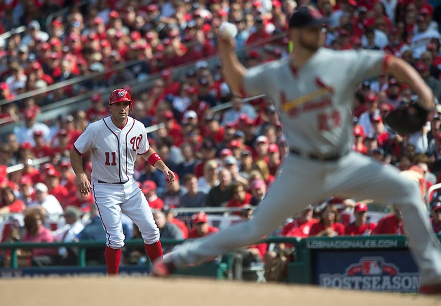 Nationals' Ryan Zimmerman takes a lead off first base in the bottom of the first inning as the Washington Nationals host the St. Louis Cardinals for Game 3 of the National League Division Series at Nationals Park in Washington, D.C., Wednesday, Oct. 10, 2012. (Rod Lamkey Jr./The Washington Times)