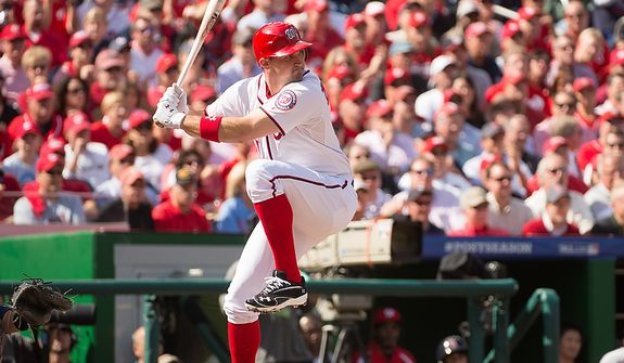 Washington Nationals third baseman Ryan Zimmerman (11) winds up to hit a single in the first inning as the Washington Nationals play the St. Louis Cardinals in game three of Major League Baseball playoffs at Nationals Park, Washington, D.C., Wednesday, October 10, 2012. (Andrew Harnik/The Washington Times)