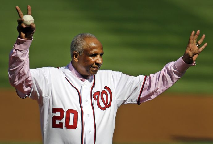 Former Washington Nationals manager Frank Robinson acknowledges fans before throwing out the ceremonial first pitch before Game 3 of the National League division baseball series between the Nationals and the St. Louis Cardinals on Wednesday, Oct. 10, 2012, in Washington. (AP Photo/Pablo Martinez Monsivais)