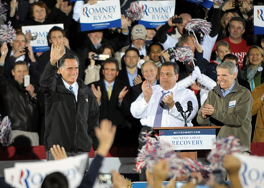 Republican presidential candidate Mitt Romney campaigns with New Jersey Gov. Chris Christie (center) and Sen. Rob Portman (right), Ohio Republican, in Cuyahoga Falls, Ohio, on Tuesday, Oct. 9, 2012. (AP Photo/Mark Stahl)
