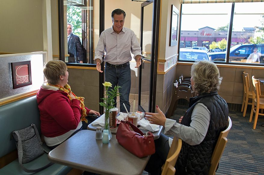 Republican presidential candidate Mitt Romney walks into a Wendy's restaurant during a surprise stop on Tuesday, Oct. 9, 2012, in Cuyahoga Falls, Ohio. (AP Photo/Evan Vucci)