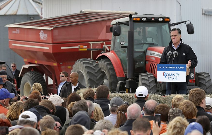 Republican presidential candidate Mitt Romney speaks during a campaign stop at the Koch family farm on Tuesday, Oct. 9, 2012, in Van Meter, Iowa. (AP Photo/Charlie Neibergall)