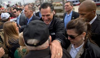 Republican presidential candidate Mitt Romney shakes hands during a campaign rally on Tuesday, Oct. 9, 2012, in Van Meter, Iowa. (AP Photo/Evan Vucci)