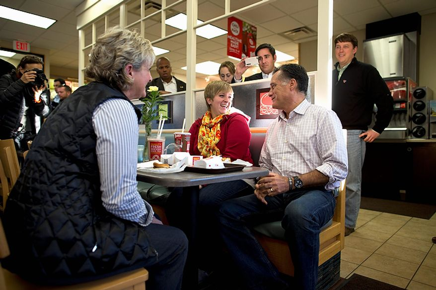 Republican presidential candidate Mitt Romney talks with patrons at a Wendy's restaurant after making a surprise visit on Tuesday, Oct. 9, 2012, in Cuyahoga Falls, Ohio. (AP Photo/Evan Vucci)