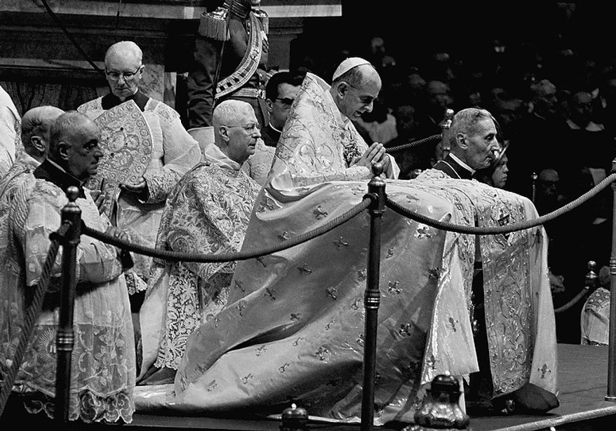 Pope Paul VI kneels in prayer in St. Peter's Basilica in the Vatican on Sept. 29, 1963, during the opening ceremony for the second phase of the Ecumenical Council of the Roman Catholic Church. At left is Cardinal Alberto di Jorio, a member of the Vatican Curia.  At right is Monsignor Enrico Dante, prefect of Vatican ceremonies. (AP Photo)