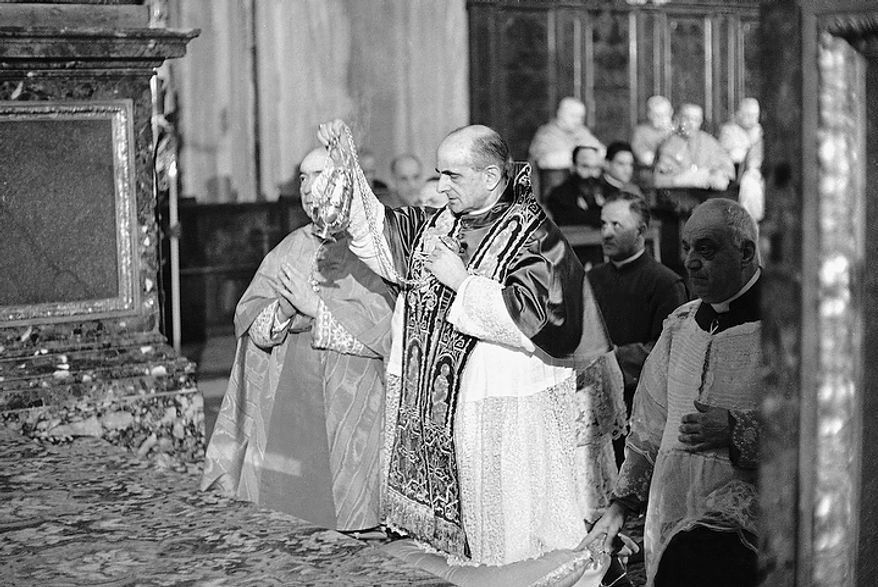 Pope Paul VI incenses the altar of the Basilica of Saint Mary Major in Rome during a solemn religious ceremony on the first anniversary of the opening of the Roman Catholic Ecumenical Council, Oct. 11, 1963.  About 2,000 of the 2,500 Council Fathers gathered for the second session of the Council, attended the ceremony.  (AP Photo/Girolamo Di Majo)
