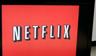 """On this July 25, 2008, file photo, Netflix CEO Reed Hastings poses for a photo at Netflix headquarters in Los Gatos, Calif. A new book,""""Netflixed: The Epic Battle for America's Eyeballs,"""" is set to go on sale Thursday, Oct. 11, 2012. The book tries to debunk a widely told tale about the company's origins and paints a polarizing portrait of its star CEO Reed Hastings. (AP Photo/Paul Sakuma)"""