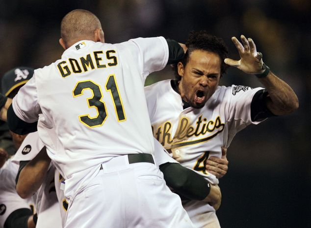 Oakland Athletics left fielder Coco Crisp (4) celebrates after he hit single to score Seth Smith and win the game 4-3 in the ninth inning of Game 4 of an American League division baseball series against the Detroit Tigers in Oakland, Calif., Wednesday, Oct. 10, 2012.(AP Photo/Ben Margot)