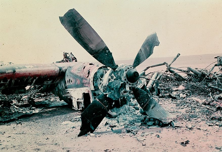 The burned out wreckage of a U.S. aircraft lies in the desert some 300 miles south of Tehran after the abortive commando-style raid into Iran, April 1980, aimed at freeing the American hostages being held in Tehran.  The rescue mission fell apart when several helicopters failed and a helicopter and C141 transport plane collided.  At least 8 U.S. servicemen died in the mission.  (AP Photo)