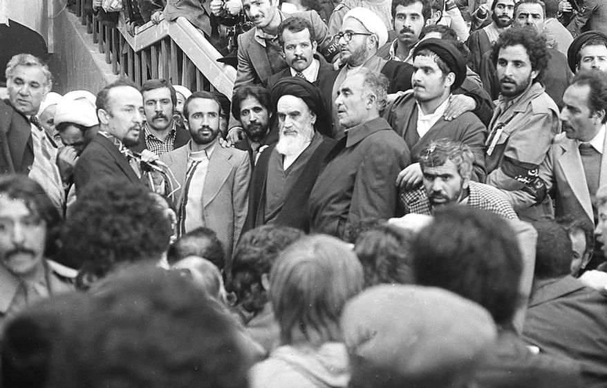 Ayatollah Ruhollah Khomeini, center, is surrounded by followers, Feb. 1, 1979, after his arrival at Mehrabad Airport after 14 years of exile.  (AP Photo)