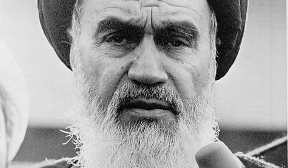 The Ayatollah Ruhollah Khomeini, Iran's exiled religious leader, speaks on Jan. 25, 1979, at a news conference following morning prayers.  Through an interpreter he told newsmen that he was postponing his return to Tehran because of  the Iranian Army's closure of the airports.  (AP Photo)