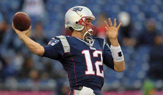 New England Patriots quarterback Tom Brady warms up before an NFL football game against the Denver Broncos Sunday, Oct. 7, 2012 in Foxborough, Mass. (AP Photo/Steven Senne)