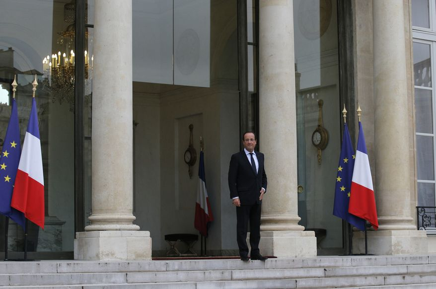 French President Francois Hollande wait for Microsoft founder Bill Gates and, and Irish performer Bono, unseen, before a meeting at the Elysee Palace, in Paris, Wednesday, Oct. 10, 2012. (AP Photo/Christophe Ena)