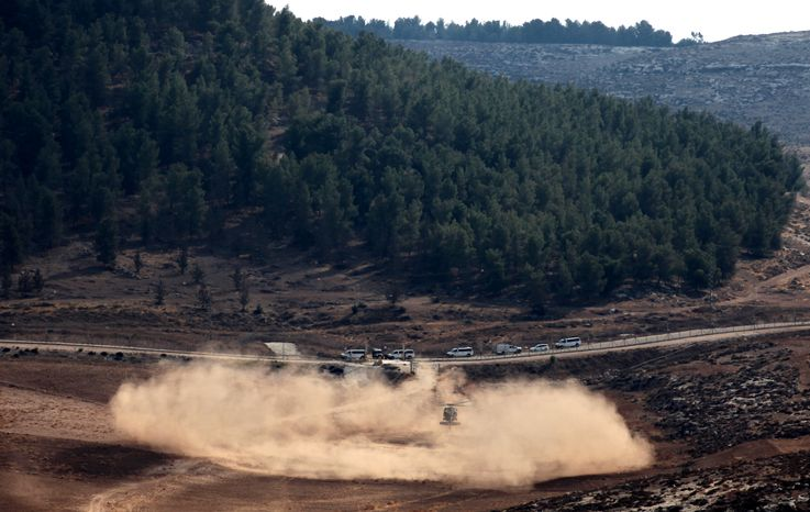 An Israeli army helicopter lands in an open area as soldiers search for the remains of a drone in the Negev in southern Israel on Saturday, Oct. 6, 2012. (AP Photo/Yehuda Lachiani)