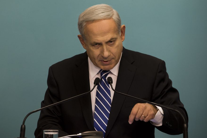Israeli Prime Minister Benjamin Netanyahu speaks during a press conference at his office in Jerusalem on Tuesday, Oct. 9, 2012. Mr. Netanyahu has ordered new parliamentary elections in early 2013, roughly eight months ahead of schedule. (AP Photo/Bernat Armangue)
