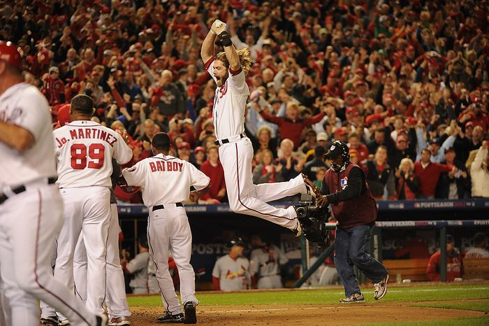 Washington Nationals right fielder Jayson Werth (28) jumps for joy before he crosses the plate with a ninth-inning walk-off home run to give the Nats a 2-1 win in Game 4 of the National League Division Series, evening the series at 2-2, between the Washington Nationals and the St. Louis Cardinals at Nationals Park, Thursday, October 11, 2012. (Andrew Harnik/The Washington Times)